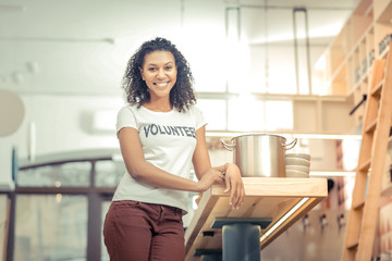 Delighted nice woman standing in the kitchen