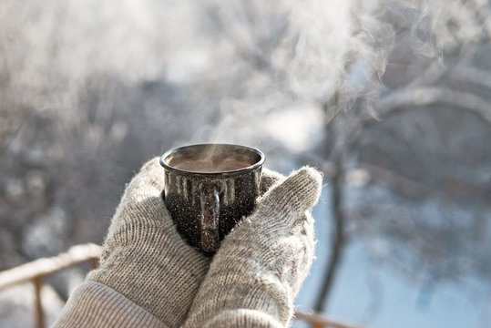 Woman hands holding hot cup coffee, tea
