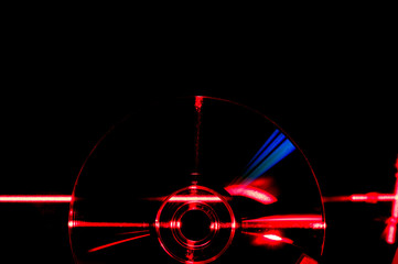 beautiful abstraction glowing DVD disc in red laser beams