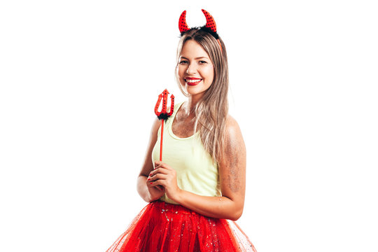 Young lady wearing devil halloween or carnival costume