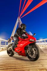 Red bike on a bridge