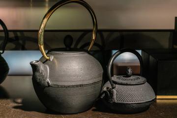 Two asian black teapots