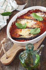Vegetable gratin. Baked eggplants in tomato sauce with grated cheese