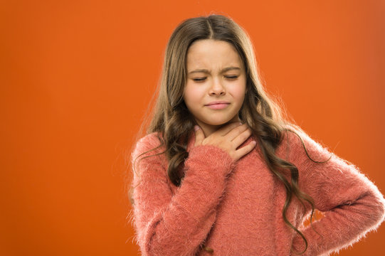 Lost her voice. Sore throat quick remedies. Kid feel pain in throat. Suffer from pain neck. Girl painful face orange background. Health care and medicine. Sore throat remedies. Throat pain treatment