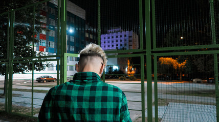 Guy on the Playground at night.