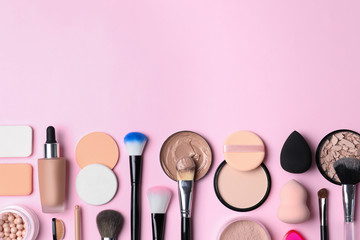 Flat lay composition with skin foundation, powder and beauty accessories on color background. Space for text Wall mural