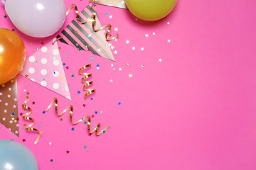 Fotobehang - Flat lay composition with balloons and party accessories on color background, space for text
