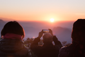 People Taking Photos of Sunrise Over Mountains on a Hike in Nepal
