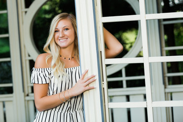 High School Senior Photo of Blonde Caucasian Girl Outdoors in Romper Dress