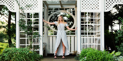 High School Senior Photo of Blonde Caucasian Girl Outdoors in Romper Dress