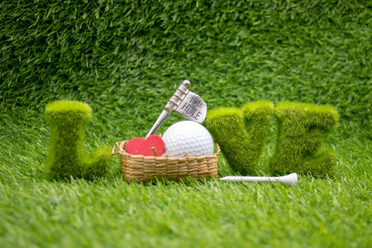 To golfer with love with golf ball on green