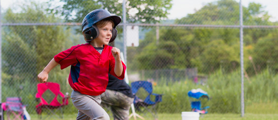 Young Child Running During a Baseball Game