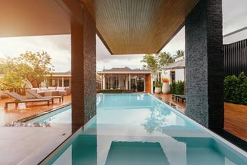 Private swimming pool near luxury villa. Sunny summer travel vacation