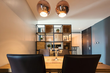Modern kitchen and dining table in studio interior