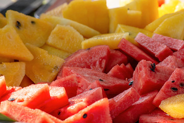 Watermelon red and yellow cut a small piece for eating.
