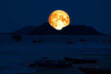 super blood moon back on silhouette island sea on night sky