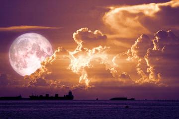 super snow moon back on sunset sky silhouette cloud on sea