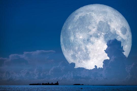 super snow moon back on night sky silhouette cloud on sea