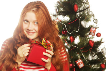 happy woman with gift box and christmas tree