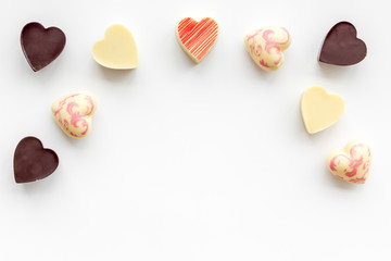 Heart-shaped confection for Valentine's day on white background top view space for text