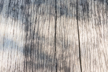 old Wooden pattern background on table got some black stain, with sun light shine on - vertical