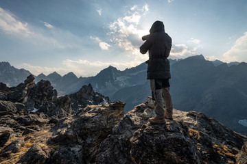 A man take picture of Himalaya mountains on top of Gokyo Ri in Everest base camp trek, Nepal
