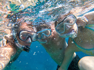 Underwater view of snorkeling friends