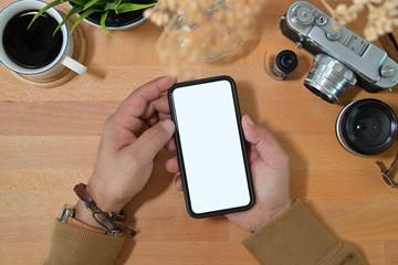 Creative stylish hand holding blank screen mobile phone