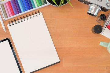 Graphic designer wooden desk essentials and copy space