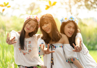 Fashion portrait of best friends, having fun together, joy and happiness, wearing trendy Flower crown, stylish vintage bohemian outfits. Fall fashion,instagram,Soft warm vintage color tone,blur. Asian