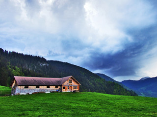 Alpine livestock farms and stables on the slopes of Churfirsten mountain range - Canton of St. Gallen, Switzerland