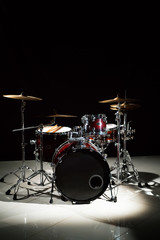 Professional drum set on stage on the black background