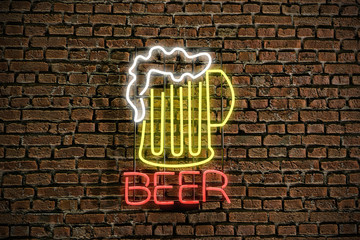beer sign on brick wall