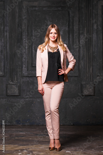 29651e53e Fashion portrait of pretty sexy young blonde woman in pink pantsuit ...