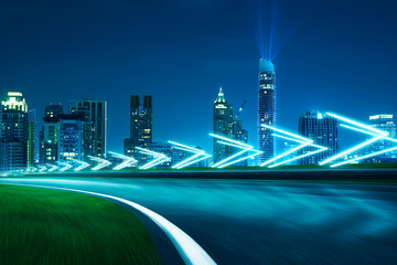 Wall Mural - Motion blurred racetrack,cityscape night scene cold mood. with arrow light Effects.