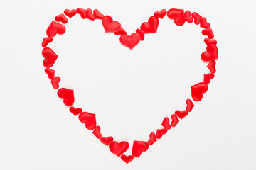 Valentines day background red hearts on white wooden background.