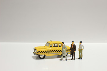 Old retro toy yellow taxi isolated on white background