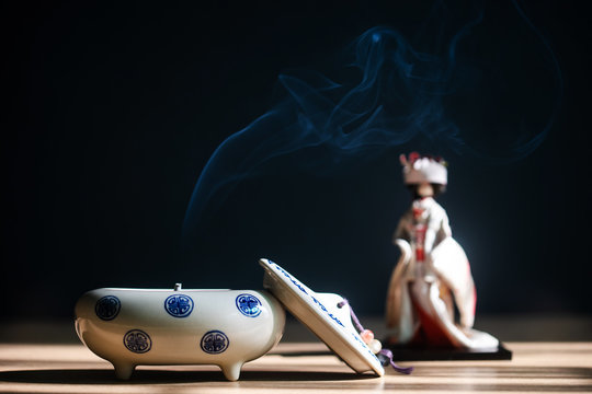 Close up of Japanese incense burner with ceramic on table