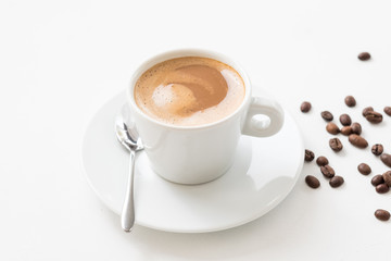 Morning hot coffee wake up concept. Latte cup and beans on white background.
