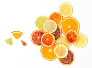 many fresh orange slices, lemon slices, lime slices, kumquat slices are nicely arranged on a white background