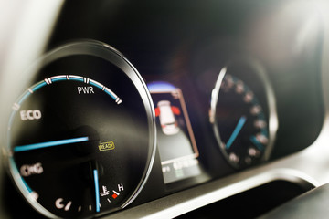 Hybrid car dashboard speedometer .