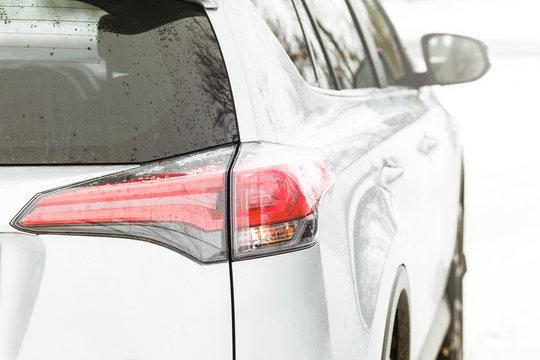 Silver SUV Modern electric car. luxury SUV rear light closeup.