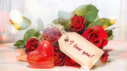 Greeting card for valentines day: I love you with red roses