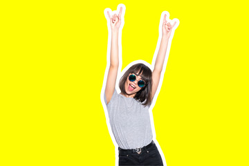 Collage in magazine style with colorful emotional fashion crazy girl in sunglasses scream with rock sign on yellow background