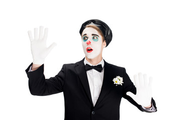 surprised clown in black suit and beret isolated on white