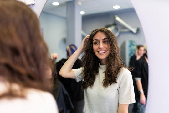 Attractive woman looking at mirror