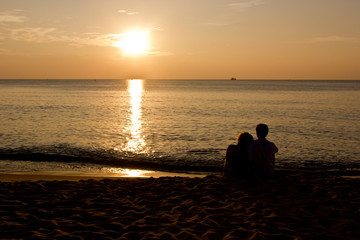 Romantic silhouette couple in the sunset