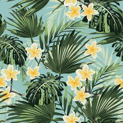 Beautiful seamless floral pattern background with exotic bright palm leaves and plumeria flowers. Perfect for wallpapers, web page backgrounds, textile. Vintage blue background.