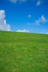 The Dyke in East Frisia, Germany (Green field and blue sky)