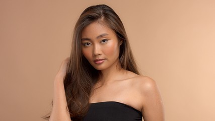 thai asian japanese model closeup portrait with hair covered her face with ideal healthy hair